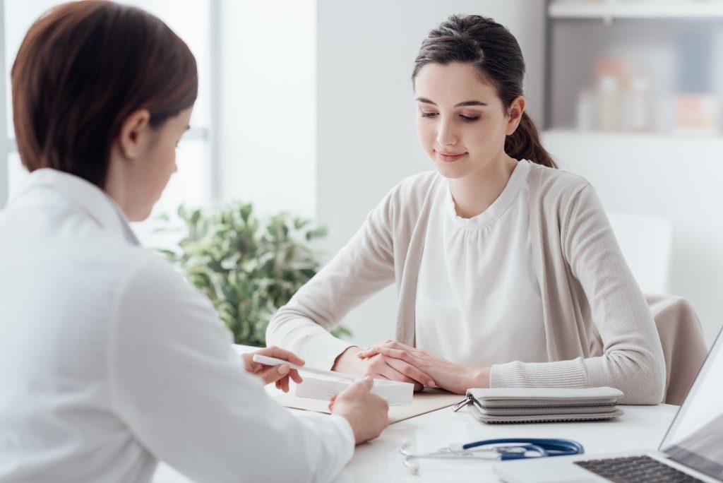Patient receiving her prescription