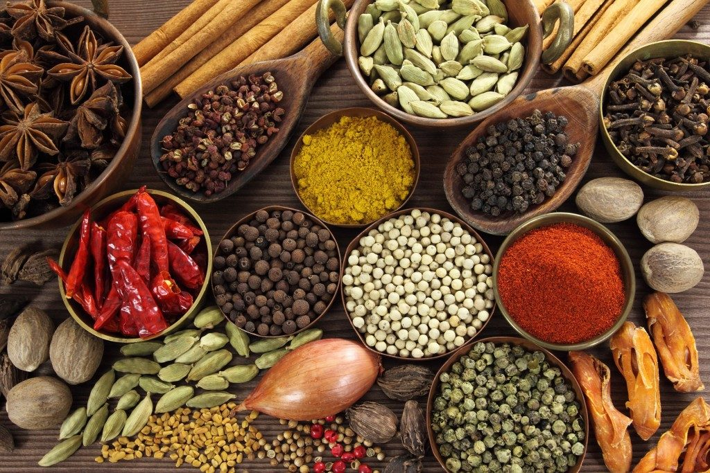 Spices and herbs on wooden surface