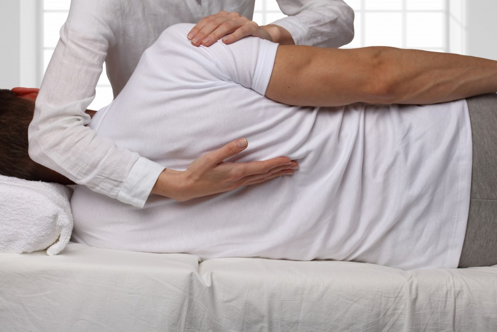 Man undergoing a back chiropractic treatment
