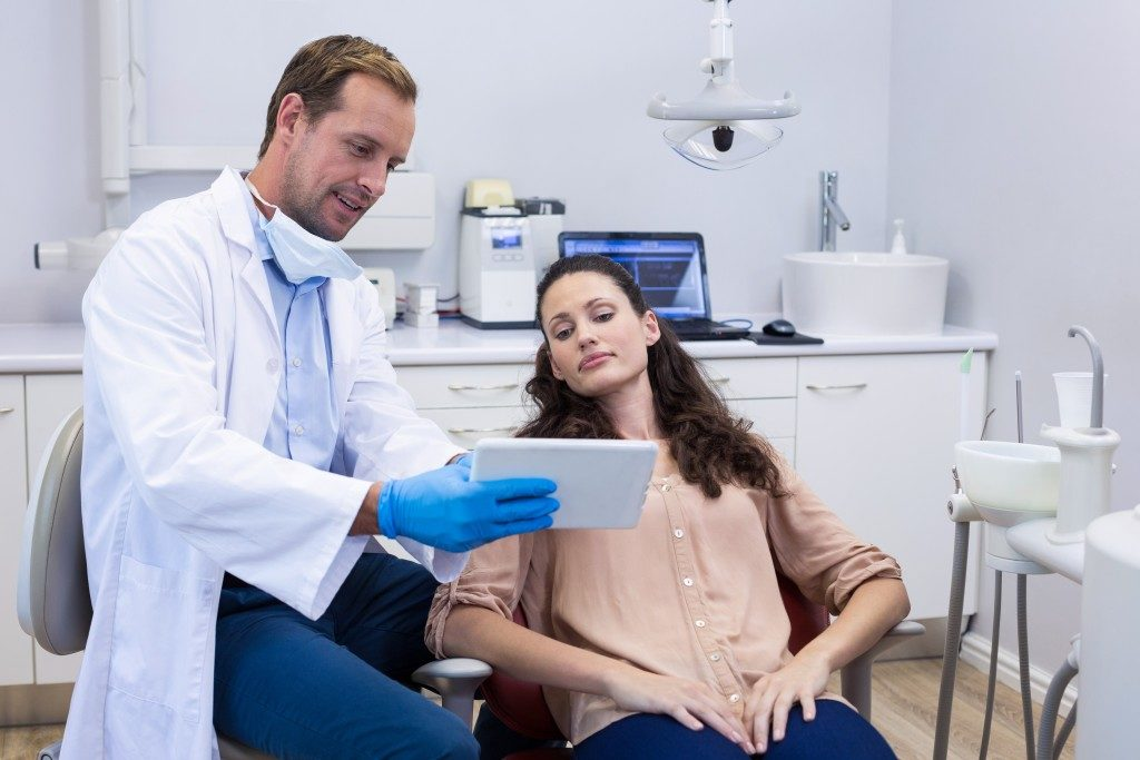 dentist talking to patient