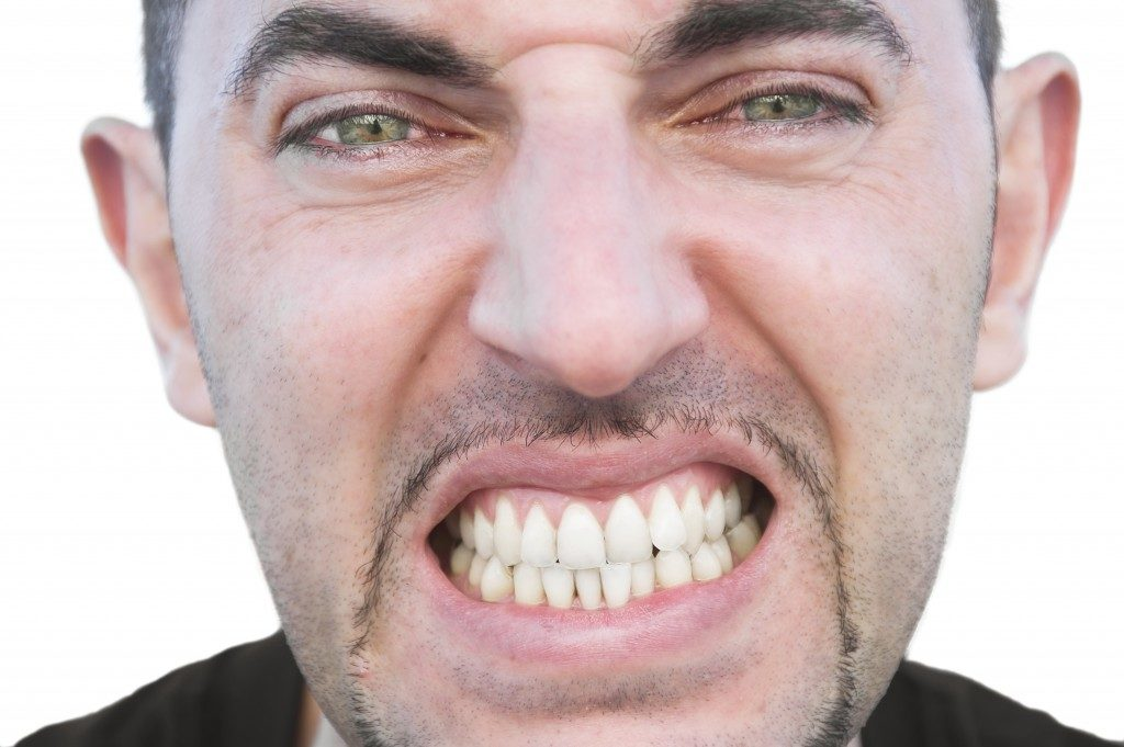 Concept of teeth grinding on man