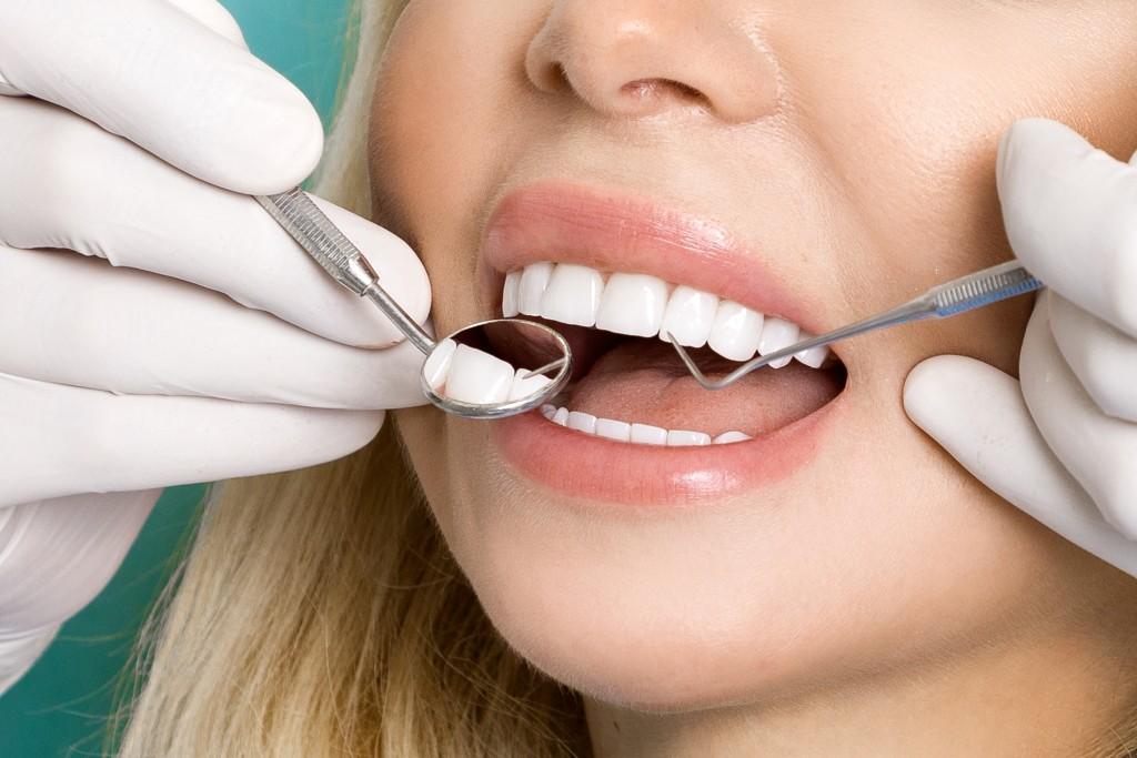 Girl having her teeth checked