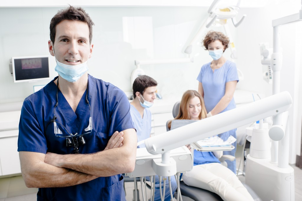 dentist with his team working