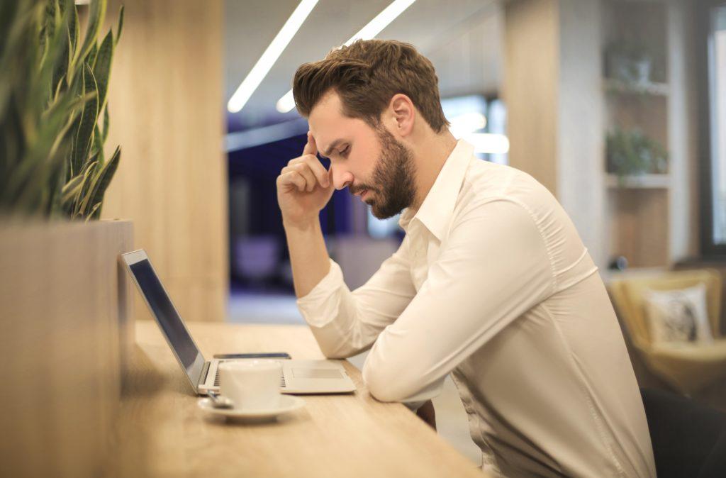Man with headache at work