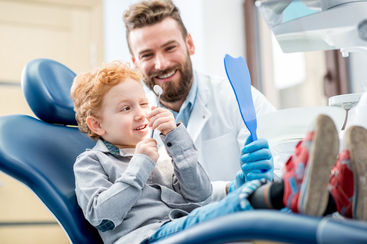 kid in the dental clinic