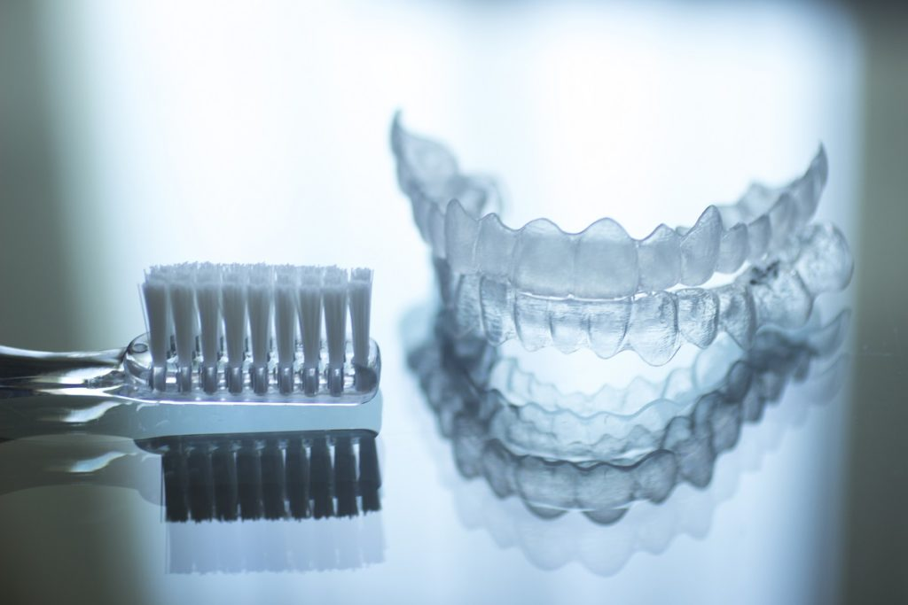 invisalign and toothbrush
