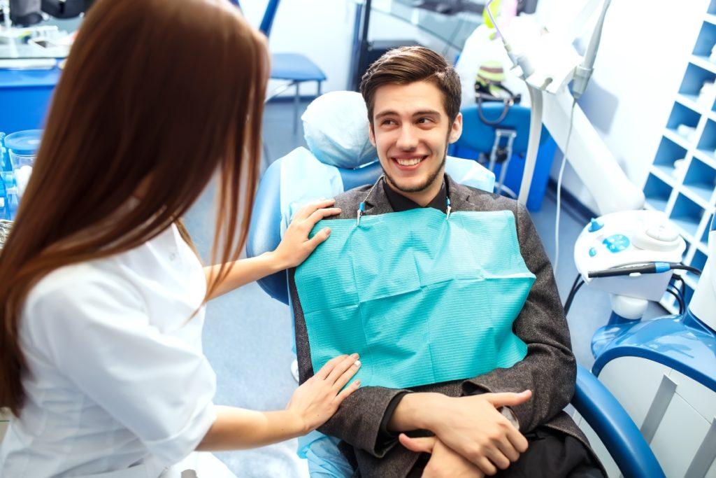 man smiling at a dentist
